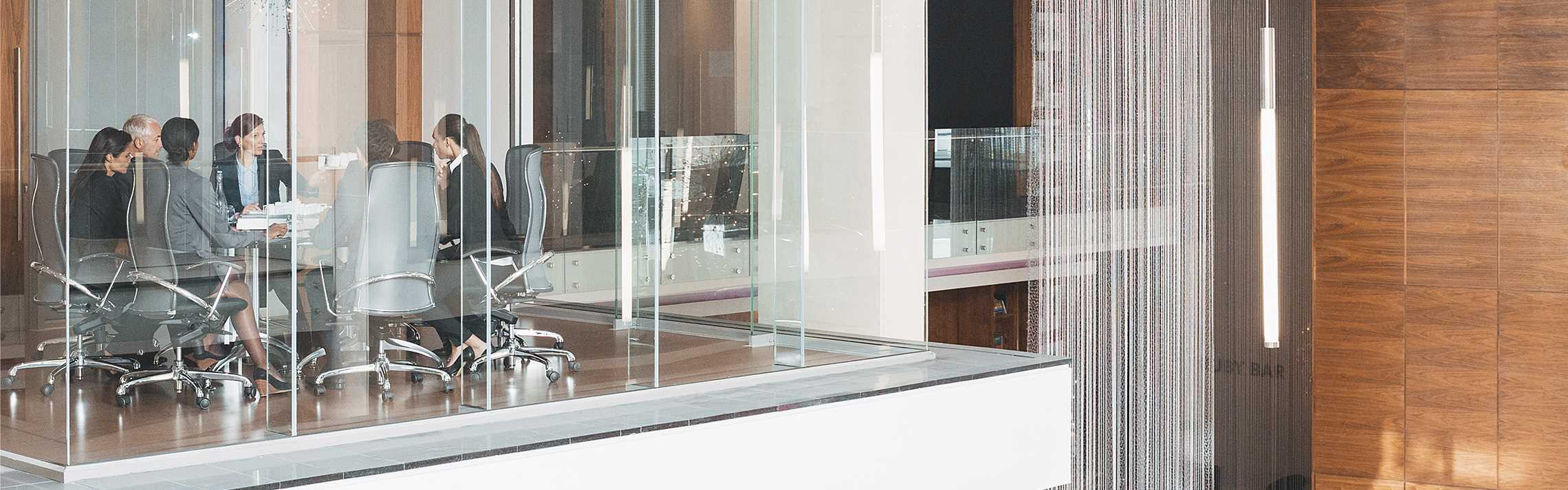 Glass meeting room in modern office.
